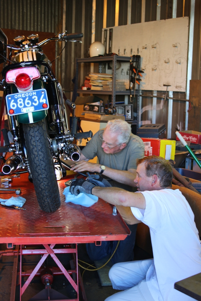 Mike working with Brit bike guru Dave Wedlake putting the finishing touches on Mike's Triumph.