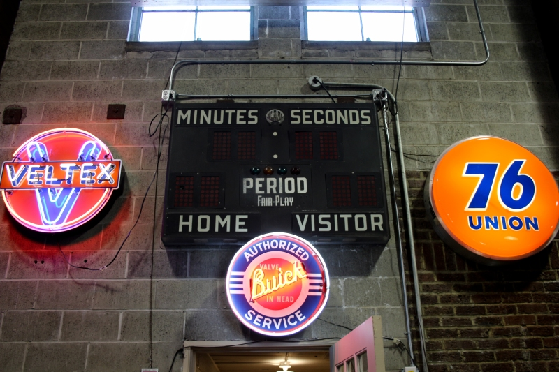 The original scoreboard shares space with old neon.
