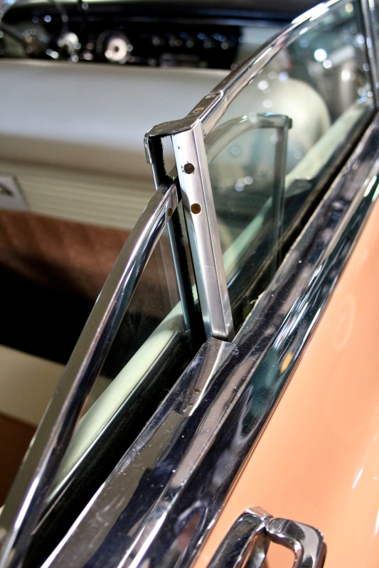 Details like this are why vintage cars are so fun and cool. The back wing window rotates forward and through the frame of the front window to completely disappear when rolled all the way down.